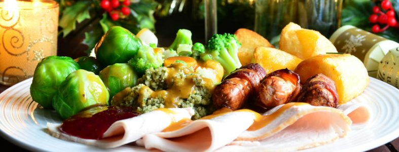 Photo of a Christmas meal with roast potatoes and sprouts